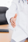 Doctor holding out his hand for a handshake Royalty Free Stock Photo