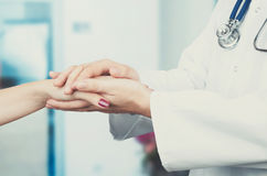 Doctor holding patient hand close up stock photos