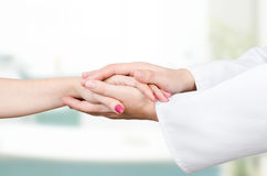 Doctor holding patient hand close up stock image