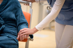 Doctor holding patient hand Stock Image