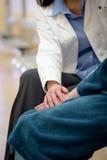 Doctor holding patient hands Stock Photos