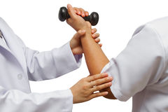 Doctor holding patient 's elbow for rehab Stock Images