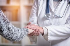 Free Doctor Holding Patient`s Hand Royalty Free Stock Photo - 104764845