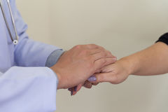 7Doctor holding patient& x27;s hand, helping hand concept Royalty Free Stock Photography