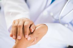 Doctor holding patient`s hand. Medicine and health care concept. Doctor and patient stock photography