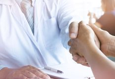 Doctor holding patient& x27;s hand, and reassuring his male patient h royalty free stock photo