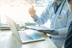 Doctor Holding Pens and Mentoring Patients, Treating Cancer and Introducing,. Taking Care of Yourself royalty free stock photo