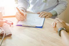 Doctor Holding Pens and Mentoring Patients, Treating Cancer and Introducing. Taking Care of Yourself stock photography
