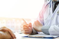Doctor Holding Pens and Mentoring Patients, Treating Cancer and Introducing, Taking Care of Yourself. Doctor Holding a pens and Mentoring Patients, Treating stock photography