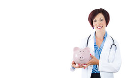 Doctor holding piggy bank. Stock Image
