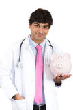 Doctor holding piggy bank. Medical insurance, medicare reimbursement Royalty Free Stock Image