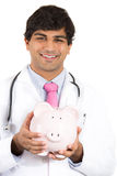 Doctor holding piggy bank. Medical insurance, medicare reimbursement Stock Photo
