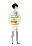 Doctor holding pile of folders. Royalty Free Stock Photos