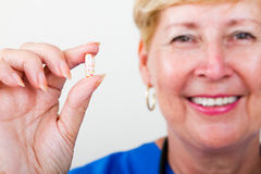 Doctor holding pill Royalty Free Stock Photo