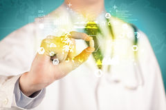 Doctor holding a pill between fingers Royalty Free Stock Photos