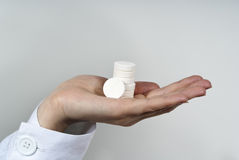 Doctor holding pills Royalty Free Stock Image