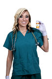 Doctor Holding Pills. A beautiful young female doctor on her rounds holding a prescription bottle of medicine pills royalty free stock images