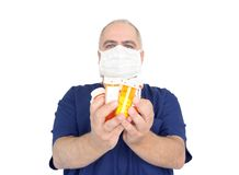 Doctor holding pills. Doctor holding many pill bottles isolated on white Royalty Free Stock Photos