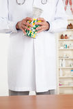 Doctor Holding Pills Bottle Royalty Free Stock Photos