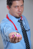 Doctor Holding Pills in Hand royalty free stock images