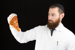 Doctor holding pizza. Royalty Free Stock Images