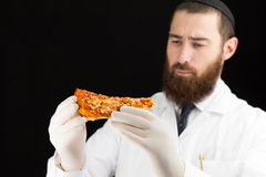 Doctor holding pizza. Royalty Free Stock Photo