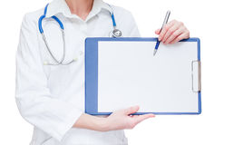 Doctor holding and pointing to space of clipboard Stock Photos