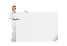 Doctor holding poster Stock Image