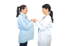 Doctor holding pregnant hands stock photos