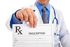 Doctor holding prescription Royalty Free Stock Photos