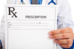 Doctor holding prescription Royalty Free Stock Photography