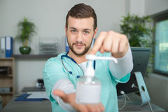 Doctor holding pump dispenser antibacterial handwash Stock Photo