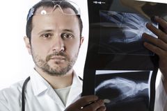 Doctor holding an x-ray appeal of a hand. Hospital Royalty Free Stock Photo