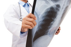 Doctor holding x-ray or roentgen image. Royalty Free Stock Photos