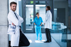 Doctor holding x-ray standing against the wall and smiling Royalty Free Stock Photo
