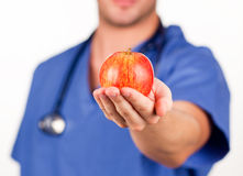 Doctor holding a red apple Royalty Free Stock Photography