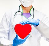 Doctor holding red heart Stock Image