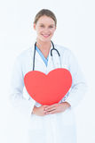 Doctor holding red heart card Royalty Free Stock Photos