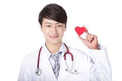 Doctor holding a red love heart pillow Royalty Free Stock Photos