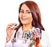 Doctor holding remedy. Royalty Free Stock Photo