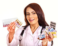 Doctor holding remedy. Royalty Free Stock Image