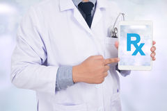 Doctor holding Rx sign stock photos