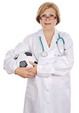 Doctor holding soccer ball Stock Photos