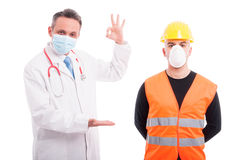 Doctor holding something and showing okay with constructor aside. Isolated on white background with copy text space Royalty Free Stock Photos