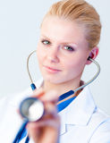 Doctor Holding Stethesope Royalty Free Stock Photos