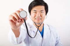 Doctor holding stethoscope Stock Photos