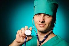 Doctor holding stethoscope Royalty Free Stock Photos