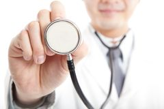 Doctor holding stethoscope Royalty Free Stock Photo