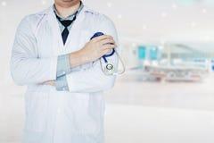 Doctor holding a stethoscope on background of hospital ward.  Stock Photos