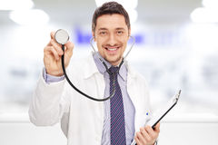 Doctor holding a stethoscope and a clipboard Stock Image